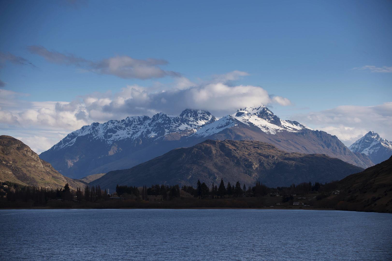 lake hayes queenstown snow covered peaks