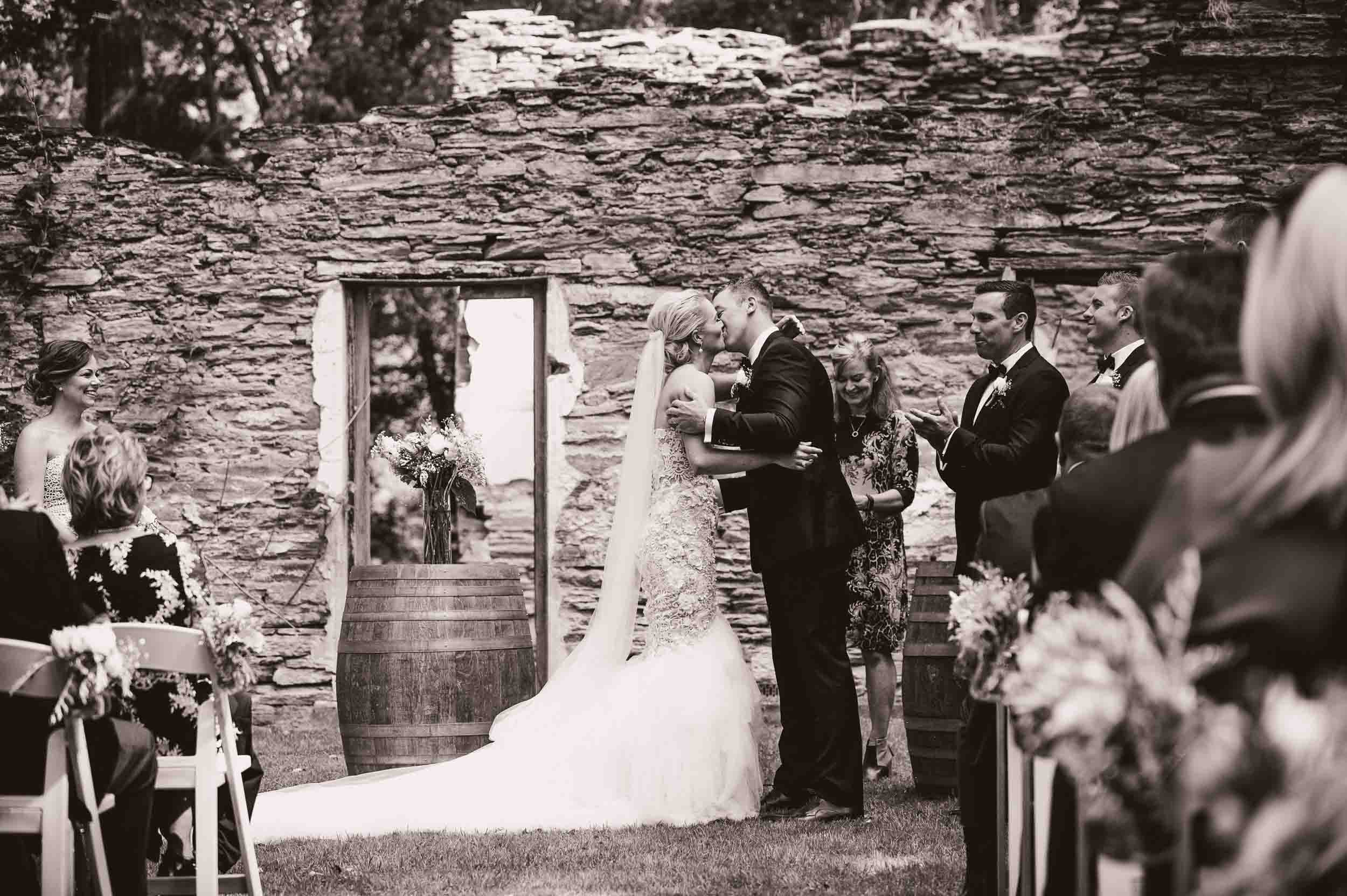 Thurlby Domain ruins wedding ceremony bride groom first kiss