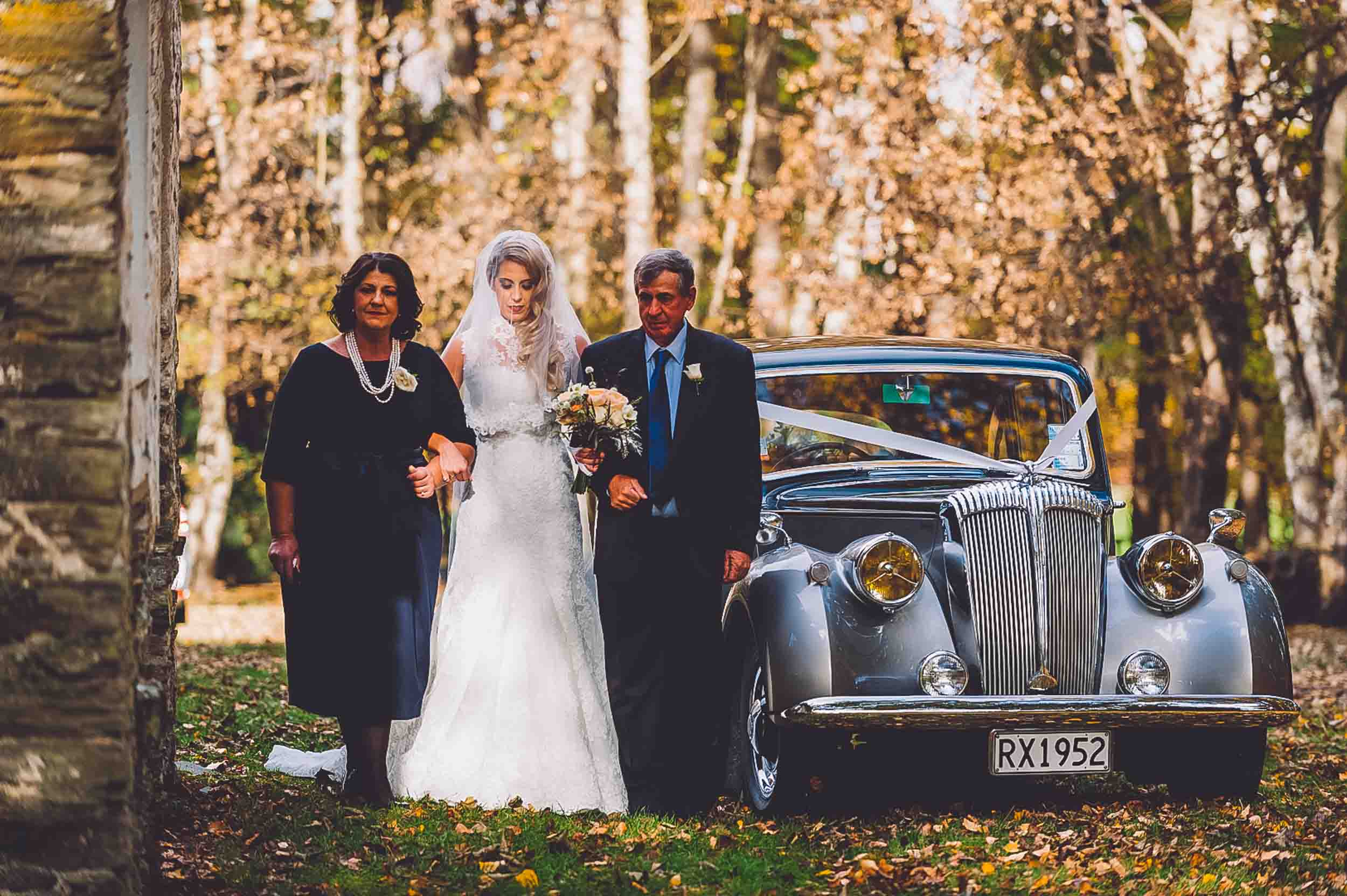 Thurlby Domain bride walking down the aisle vintage wedding car
