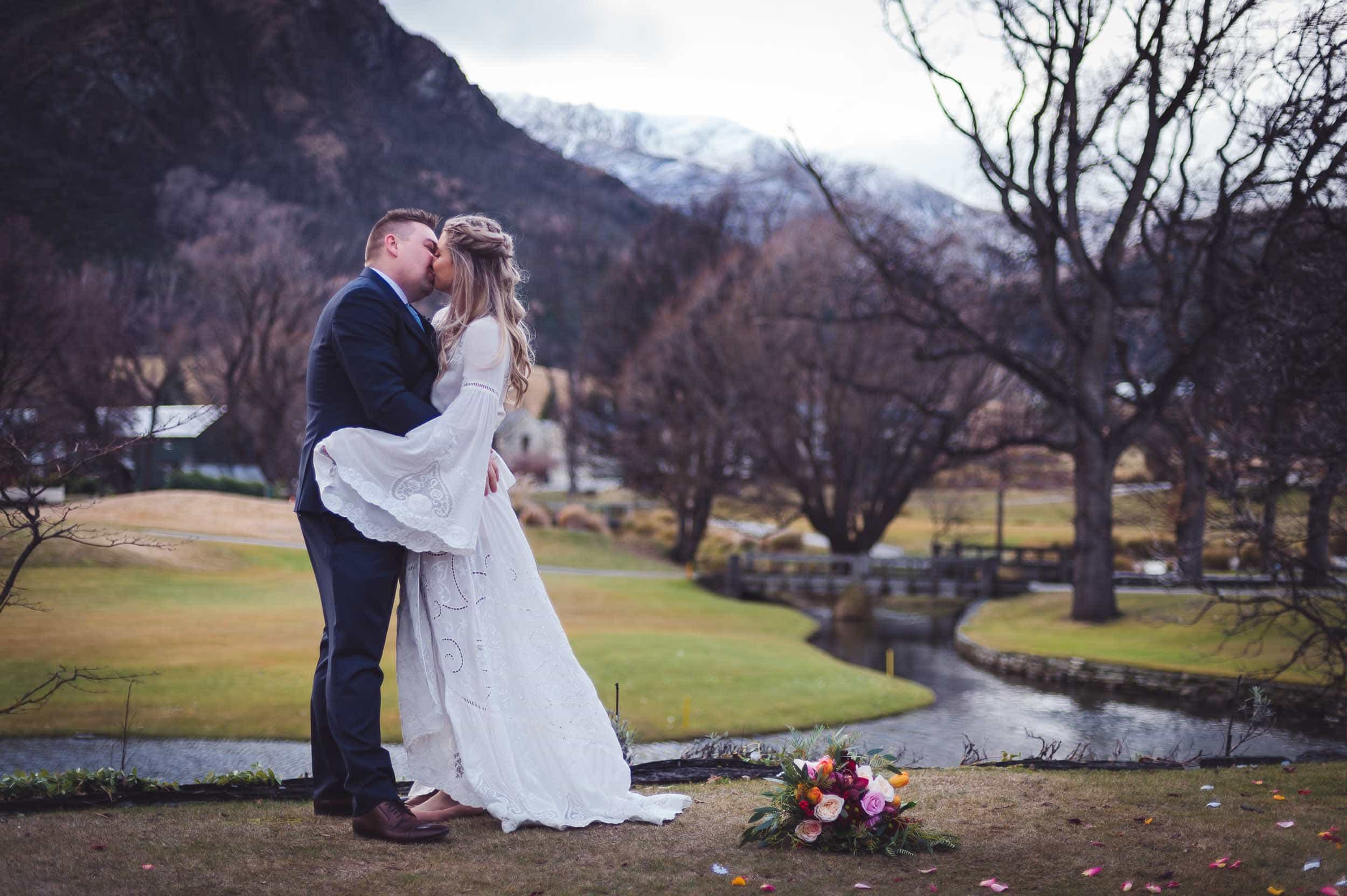Millbrook resort winter wedding secret garden ceremony bride groom kiss