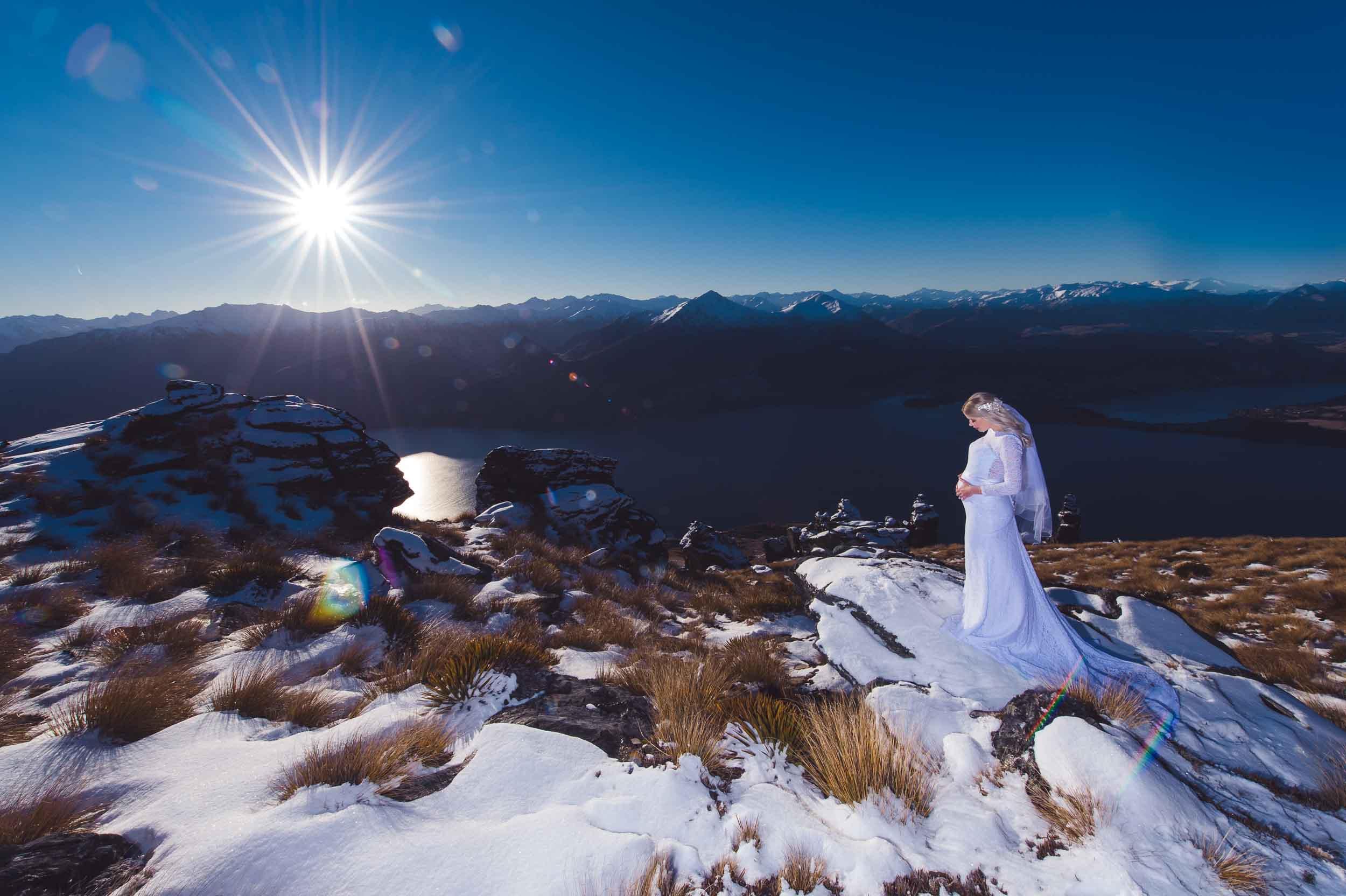Queenstown destination elopement Cecil Peak snowy helicopter bride groom
