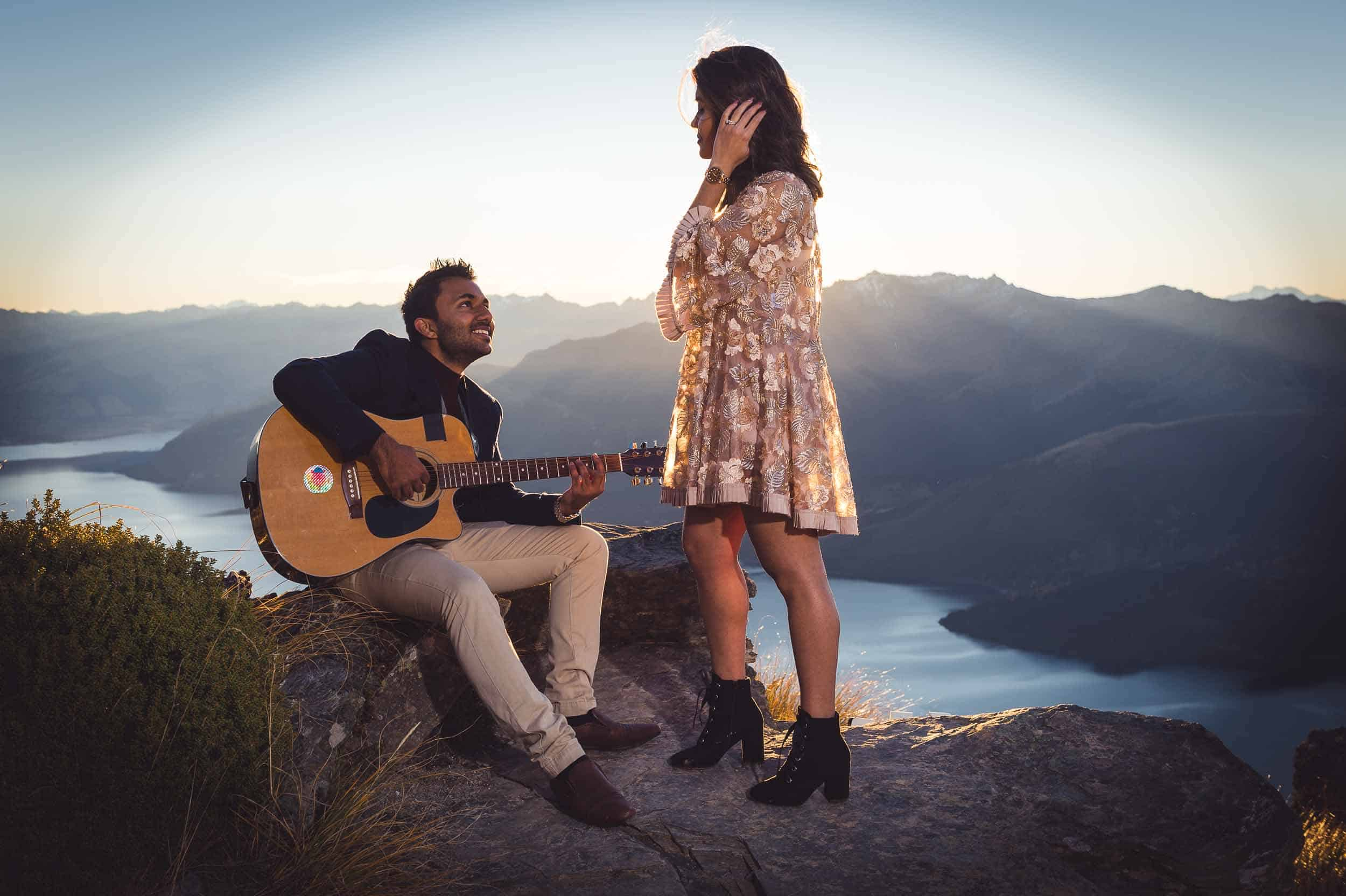 Roahan serenades Sujata at The Ledge, Cecil Peak shortly after proposing to her (she said yes). The Ledge is one of my favourite Queenstown Proposal Locations EX engagement master folder